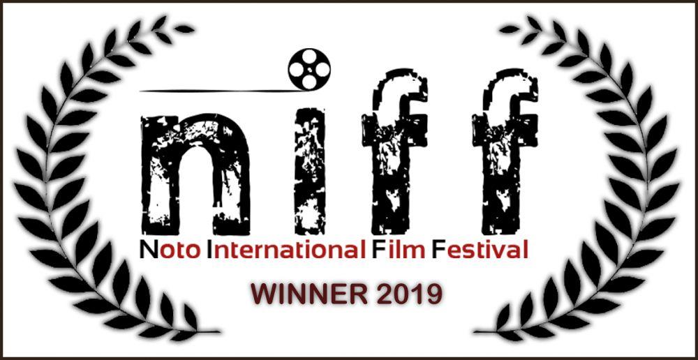 Logo of N.I.F.F. - Noto International Film Festival PREMIO MARIO MONICELLI ALLA MIGLIOR REGIA